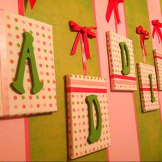Fabric covered canvas with painted wood letters.