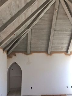 A light wash of white is applied on top of the gray to bring out the grain texture of the wood. ceiling treatment for big den? New Homes, Updating House, Grey Ceiling, Wood Ceilings, Gray Stained Wood, House, Grey Ceiling Paint, Home, Grey Stained Wood