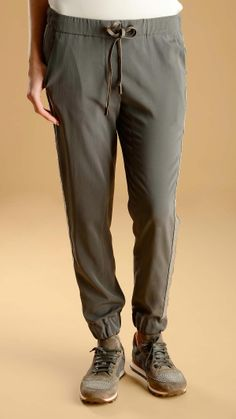 Luxury jogging waistband crepe de chine trousers featuring gemstone detail on the side, four pockets: two slant pockets at front and two welt pockets at back, narrow ankle, made of Habotai silk with a smooth and glossy appearance, 93% silk 7% elastan.