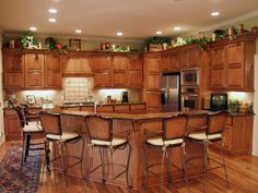 Family Friendly Kitchen - Great example of how to edge-light the room with recessed lighting.  Let us know if we can help you design your lighting layout at sylightingdesign.com !