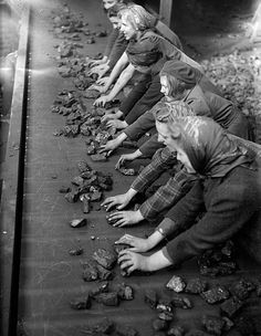 Women sorting coal on a conveyor belt, back breaking unforgiving work!
