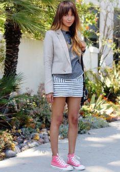knee length skirt and hi top chucks.