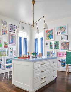 framed kid art in playroom design, bright and fun wall gallery in kid room, bonus room design with storage cabinets, craft room design iwth work island, custom cabinets in bonus room for activity and craft room design Layout Design, Design Ideas, Playroom Design, Playroom Ideas, Playroom Art, Bonus Room Playroom, Playroom Colors, Blue Playroom, Playroom Layout