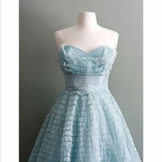 Light Blue lacey, flirty dress with ribbon waist detail.  Very 50s prom, so cute.
