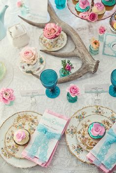Begin with a lace panel, add some mismatched china, vintage glassware and lace wrapped menu's for a truly lovely table.