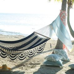 10 #beach essentials you NEED before August. (See them all on domino--link in bio, and YES this hammock is available.)  ☀️