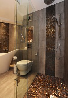 Turn your bathroom into a modern-day spa with metallic tiles