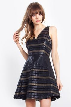$46.57 Neo Dress The Neo Dress Chic black faux leather dress. Featuring black and gold faux leather throughout. V back and a hidden zipper. Pair this with some black boots and oversized black clutch! http://www.amoyscollection.com/shop/sales/neo-dress/