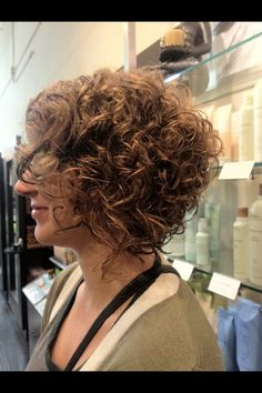 Cute curly angled Bob. Hair by Erin @ Sanctuary Salon and Spa, Seal Beach, CA for appointments call (562)431-9009 Instagram @Hair By Erin Lee www.gosanctuary.com