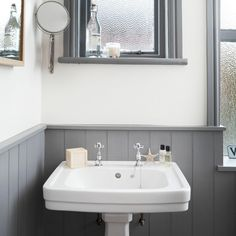 White and grey bathroom with traditional basin