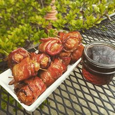 maple syrup bacon wrapped donut holes.  still cold & rainy here.  literally ran out of post x3 sp fogo charcoal on these or I would have let them go a bit longer.  cheers!  #smokingbiggreen #bge #biggreenegg #biggreeneggnation #bbq #breakfast #grilleddonut #donut #donutholes #bacon #bacondonut #baconwrappeddonutholes #maplesyrup #fogocharcoal #stillraining #positivevibes by smokingbiggreen