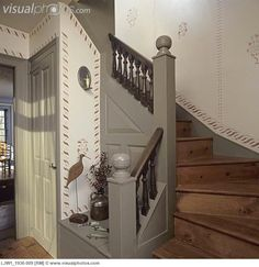 Stairs: classic colonial design, copied from original in New England, banisters painted historic accurated medium green, skirting, wall stirring and newel posts