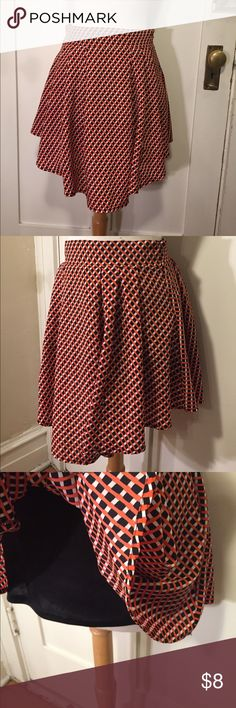 Runway story black orange white pattern skirt This is a fun black white and orange patterned skirt from runway story. Waist 28 inches, length 18 inches. See pictures for details. Good condition minor wear. Be sure and check out other items in closet and bundle to receive discounts. runway story Skirts