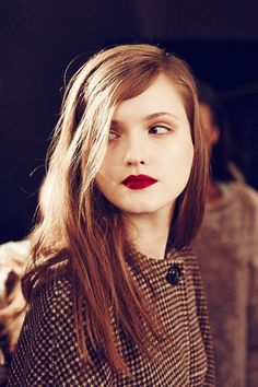 Oh my. Brown and red...what a revelation.  Brown check and red lipstick backstage at Trussardi A/W 2014