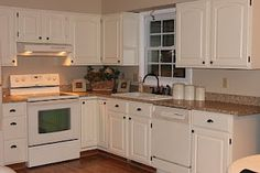 This looks very much like my kitchen layout. Now all I need to do is convince Doug to paint the old wood cabinets.