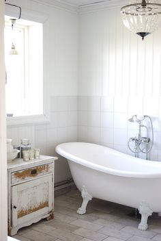 Shabby chic bathroom.  Love the tub and cabinet!