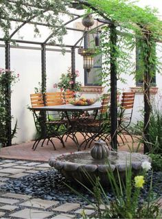 Garden ideas, Landscaping Ideas, arbor, pergola, Metal pergola, mediterranean patio, small space, smal yard, al fresco dining, climbing vines, garden structure, fountain, water feature, Carson Poetzl