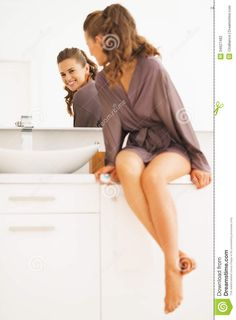 Happy Woman Looking In Mirror In Bathroom Stock Photography ...