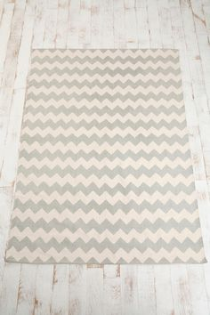 Zigzag (ie chevron) printed rug from Urban Outfitters. Cute and cheap! $39