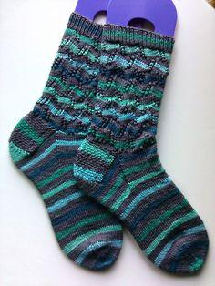 Ravelry: Tumbling Blocks Striped Socks pattern by Leah Oakley