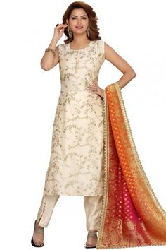 This off white chanderi silk trouser suit will instantly catch your eyes. This round neck and sleeveless wedding wear dress decorated using zari work. Set together with chanderi silk trouser pant in off white color with multi color silk dupatta Trouser pant has plain work. Dupatta designed with beads work. #trousersuit #salwarkameez #malaysia #Indianwear #Indiandresses #andaazfashion White Trousers, Trouser Suits, Différents Styles, Pantalon Cigarette, Silk Dupatta, Off White Color, Uk Fashion, Wedding Wear, Jacket Style