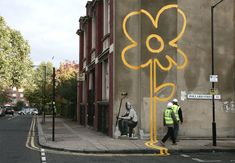 ;) Me gusta este tipo de grafitti    Road lines leading to a simple, but lovely, flower.