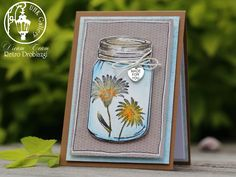 scrapbooking card, stamps, jar