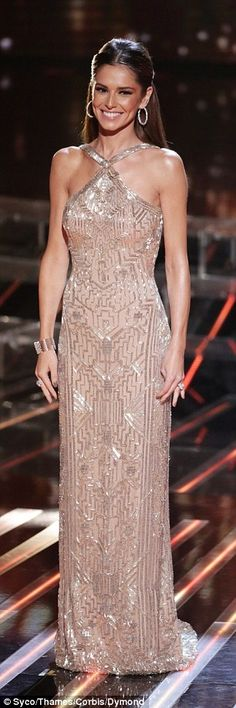 All that glitters: Cheryl Fernandez-Versini and Rita Ora didn't fail to bring the glamour on Sunday night's results show, opting for contrasting elegant and racy looks