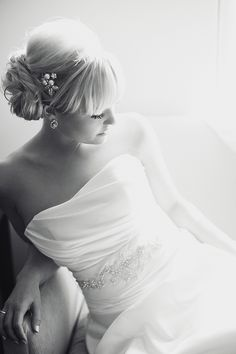 Beautiful black and white photo of this stunning bride. Love her side chignon and pearl hairpiece. Photo by Amanda Watson Photography.  www.wedsociety.com #wedding #beauty #hair #makeup