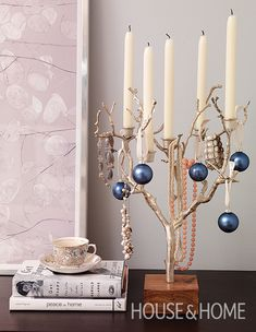 Cobalt-colored ornaments are an agreeable addition to this twig candelabra found in Lindsay Mens Craig's abode. | Photographer: Stacey Brandford | Designer: Lindsay Mens Craig