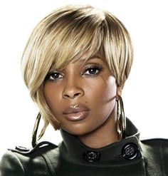 Elise Neal with black hair | black celebrity hairstyles Mary J Blige
