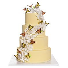 "Brides.com: Affordable Wedding Cakes. Sugar Blossom Symphony$10 per sliceFor a similar look that's easier on the wallet, Lauri suggests swapping the blooms for butterflies. ""Each butterfly is fashioned from just one piece of sugar paste, so they are much less labor-intensive to create,"" she says. ""But the finished look is just as dramatic."""