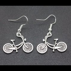 Adorable silver bicycle earrings. Silver French hook bicycle earrings. Jewelry Earrings