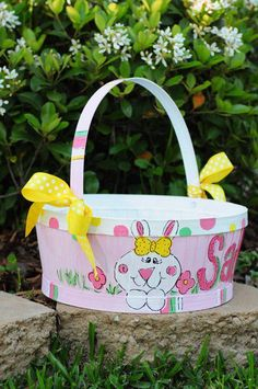 Girl Bunny Easter Basket (yellow accents)-Darling Hand Painted Easter Baskets are wonderful for Easter Egg Hunts and a great Keepsake. Colors and themes can be customized to fit your childs personality.  Demensions 10 1/4 Diameter and 4 1/2 Height   Hand Painted Easter Basket Choose your colors and theme We can create just about anything. If you have something specific you would like, (colors, theme, etc..), please contact us, and we will be happy to work with you.   Please allow two-three…