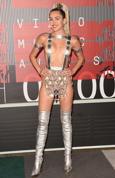 See Every Single One of Miley Cyrus's Crazy Outfits from the 2015 VMAs from InStyle.com