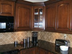 Reddish colored oak cabinets with dark granite countertop | Here are my dark cherry cabinets, with similar backsplash as 1st, but ...