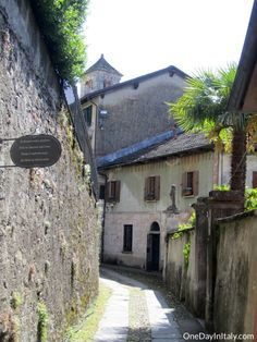The Mystical Isle of San Giulio | Walk the Path of Silence and Mediation on the tiny island of San Giulio in the middle of Italy's Lake Orta.  Once inhabited by snakes & dragons, it's now home to a 12th century basilica and monastery | Italian Travel & Culture Blog | OneDayInItaly.com