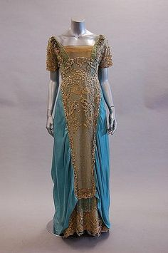Blue satin evening gown with elaborately beaded and embroidered tulle overlays, by Callot Soeurs, French, c. 1908.