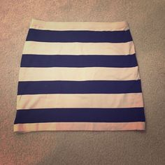 H&M Striped Skirt Sz 6/Med Super cute, stretchy skirt by H&M divided. Black and beige stripes. Could fit a small or medium. The size is six. Only worn twice. H&M Skirts Mini