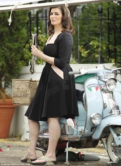 Looking good: Nigella Lawson leans against a Lambretta scooter as she films a new TV advert for the Mail On Sunday in London