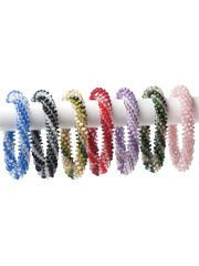 Crochet Bracelet Kits from Anniescatalog.com -- This exquisite bracelet is truly a unique accessory that will add style and glamour to your wardrobe! Each kit includes size 10 crochet cotton and wonderful glass beads ranging from dark to light with white-lined crystal highlights.