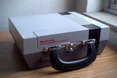 Power up your afternoon meals by encasing them inside a recycled NES lunchbox. This one of a kind lunchbox is made from a re-purposed original Nintendo console...