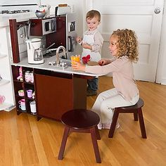 Holy FIrst World Batman! This kitchen is so damn nice I want my own...but why does that kid have a coffee maker? There's something slightly creepy about this. KidKraft Wood Play Kitchen: A Toy Kitchen That Looks Like Yours