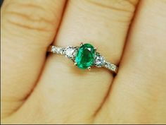 buy myself and emerald and diamond ring to pass down as an heirloom someday