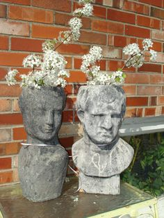 Cement head planters at my friend Janice's house.
