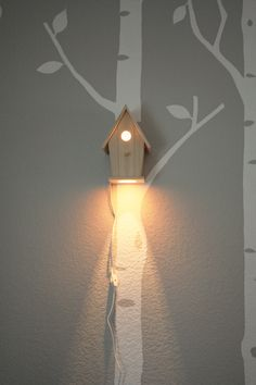 Love these modern birdhouse lamps/ night lights. So fresh for a baby room. I just did some product shots for the company... awesome peeps! moderntreetopbaby.com