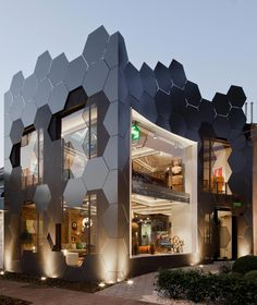 Honeycomb inspired the hexagonal shape on the facade of an furniture store in São Paulo - CAANdesign