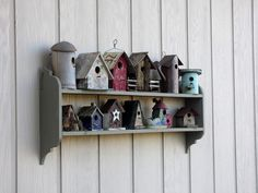 My Shelf of Birdhouses on the side of the garage