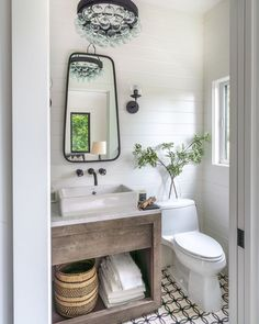 Bold and Neutral with a Baby Grand Piano modern farmhouse bathroom neutral bathroom, neutral powder room, powder room design with bathroom mirror and tile floor, bathroom vanity and bathroom sconces Spanish Bathroom, Spanish Style Bathrooms, Tiny Powder Rooms, Modern Powder Rooms, Powder Room Decor, Powder Room Design, Powder Room Mirrors, Powder Room Vanity, Bathroom Sconces
