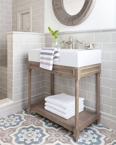 The greige shade of the Imperial Oatmeal subway tile creates an atmosphere of tranquility in this bathroom. Pair it with a patterned cement floor tile to bring more visual interest to the space. White Bathroom Tiles, Bathroom Tile Designs, Wood Bathroom, Grey Bathrooms, Bathroom Colors, Bathroom Flooring, Bathroom Interior, Modern Bathroom, Bathroom Ideas